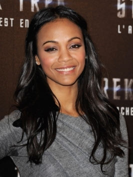 Zoe Saldana wears her shoulder-length layers styled with loose curls which give her face a girly, playful frame.