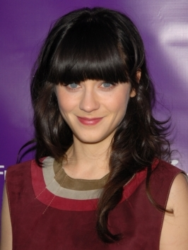 Zooey Deschanel takes her brunette locks from day to night by adding a playful headband to the look. Layers were blown out for shine and smoothness while her bangs draw attention to her striking blue eyes.