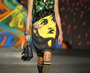 """Political wall art from Mexican muralists such as Diego Rivera"" has been Miuccia Prada's inspiration for her new line. Check out the Prada spring 2014 collection."