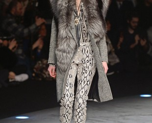 Eclectic designs displayed on a runway featuring a ring of fire hypnotized the audience present at Roberto Cavalli's fall 2014 show, so take a peek at the full eclectic lineup, next!