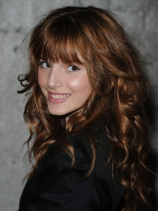 Bella Thorne Curly Hairstyle with Bangs