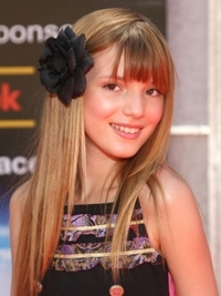 Bella Thorne Long Hairstyle with Flower