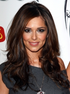 Cheryl Colr with Long Wavy Hairstyle