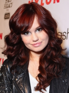 Debby Ryan's Curly Hairstyle with Side Bangs