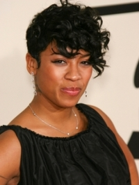 Keisha Cole Short Curly Hairstyle