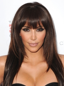 Kim Kardashian Layered Hairstyle with Bangs