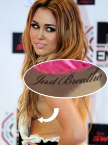 Miley Cyrus 'Just Breathe' Ribcage Tattoo