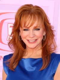 Reba McEntire Layered Haircut with Bangs