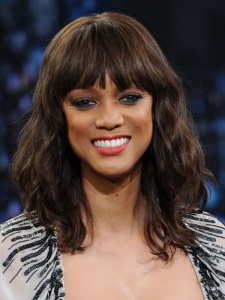 Tyra Banks Wavy Hairstyle with Bangs