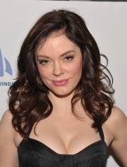 Rose McGowan colors her red strands into a classic brunette shade.