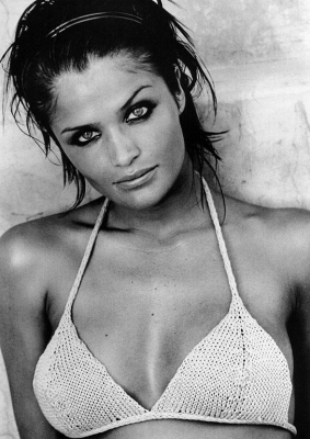 """Helena Christensen is a supermodel from Denmark who can be easily recognized as she was the model who starred in the well known music video for Chris Isaak """"Wicked Game"""". This bomb shell super beauty has the eyes of an angel and the body of a diva so no wonder she became a well known supermodel."""