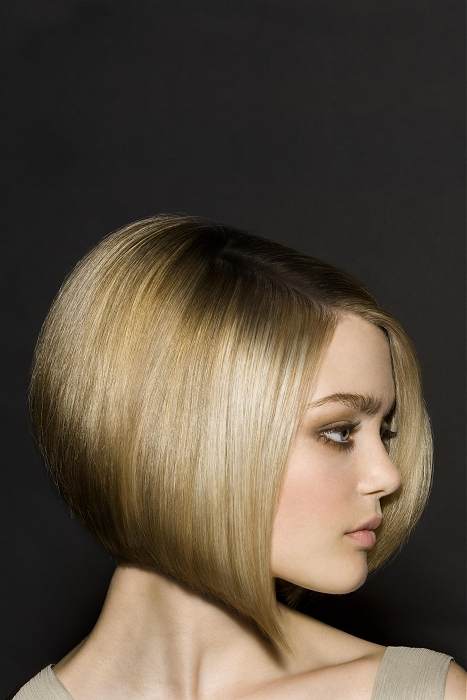 Haircut delicately highlightsthe neckline optically lengthening the