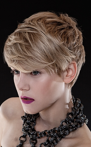 Wispy Short Haircut Wispy layers balance out the roundish and softened