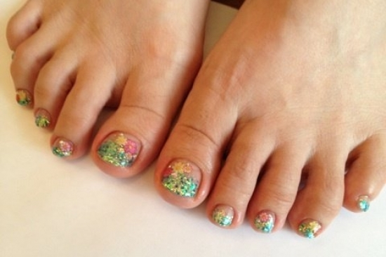 Seal the toe nail art designs using a clear top coat to ensure alonger ...