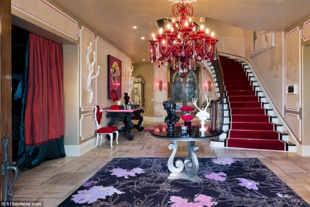Christina aguilera puts beverly hills mansion on market for Inside amazing mansions