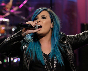 Check out Demi Lovato's new blue tresses and learn more about her upcoming nail polish line.