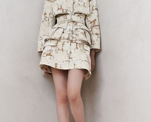 Surprisingly practical ensembles are the focus of the resort 2014 collection from Alexander McQueen. Check out the line's most representative looks.