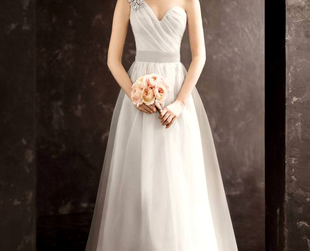 A stunning array of romantic wedding gowns and fab bridesmaid dresses define the White by Vera Wang collection available at David's Bridal.