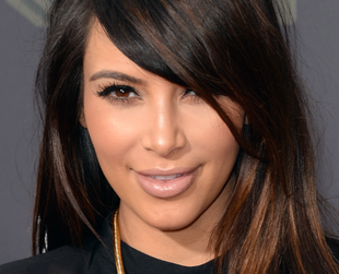 Kim Kardashian has tried a lot of hairstyles over the years, from her signature locks with a center part to her newest wavy style with bangs. See them all!