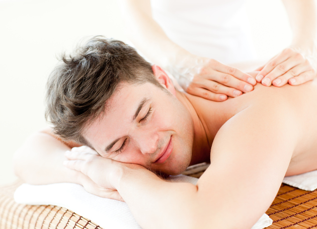 Guy Receiving A Relaxing Massage
