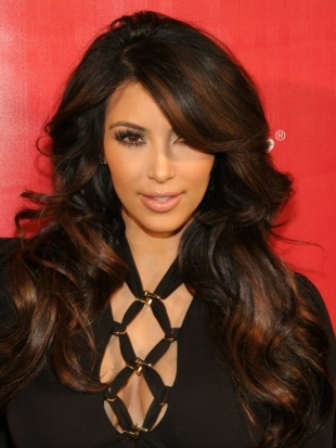 Kim Kardashian Layered Curly Hairstyle
