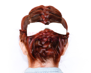Learn how to style a girly updo with multiple braids with our hair tutorial!