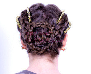 Learn how to style Kelly Osbourne's braided hairstyle with studded accents!