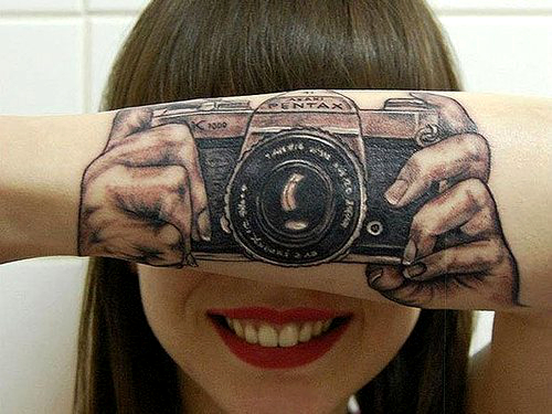 Camera Arm Tattoo