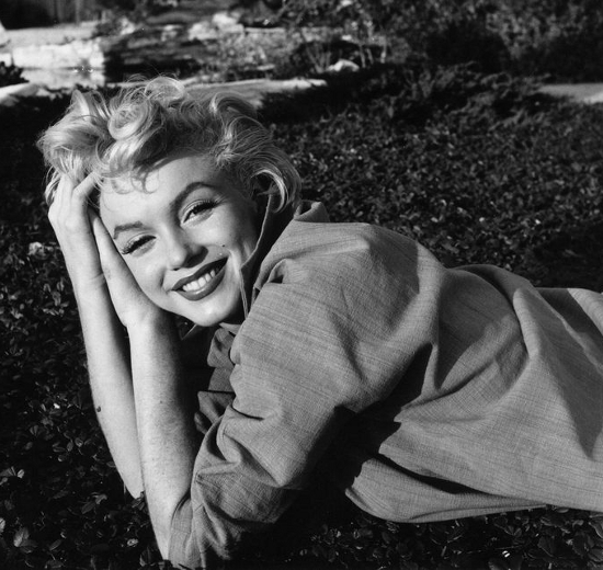 gorgeous Marilyn smiling while laying on the grass posing for the ...