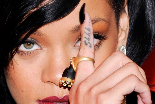 Rihanna Finger Script Tattoo
