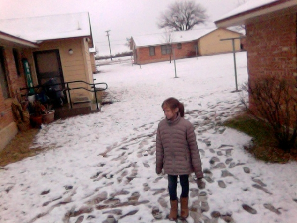 Lil_sister_standing_in_the_snow-24127